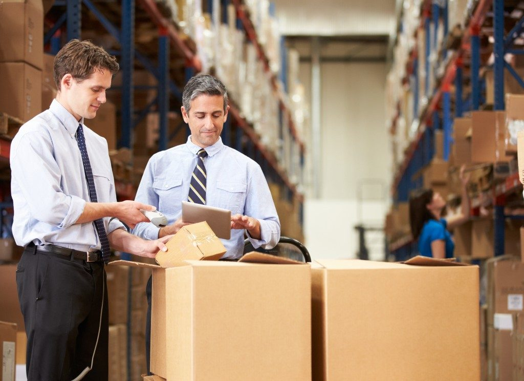 Employees scanning barcode