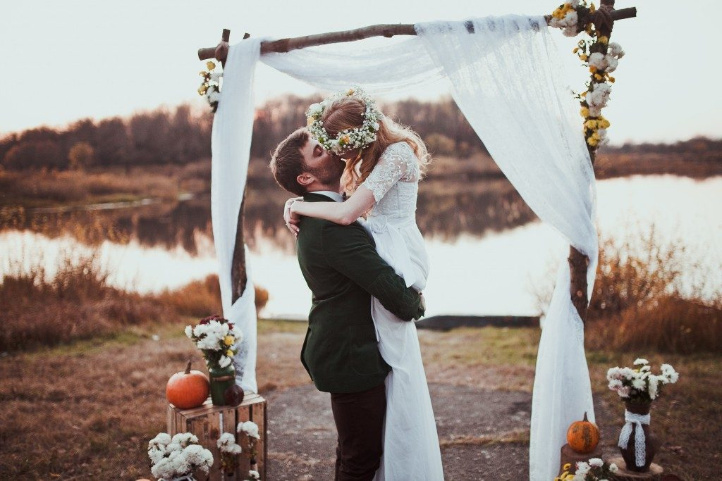 Bride and groom kissing after getting married